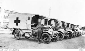 Australian Army Medical Corps ambulance vehicles parked outside No 1 Australian General Hospital, 1914.
